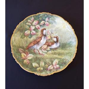 Plat peint à décor de perdrix en porcelaine datant du début du  XX°