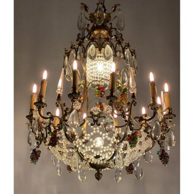 Bronze Chandelier Garnished With Tassels And Bunches Of Colorful Grapes