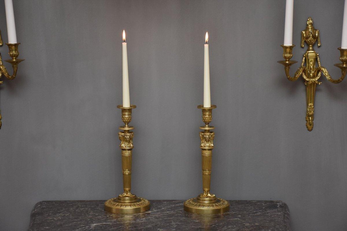 A   Pair Of Gilt Bronze Empire Candlesticks