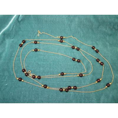 Yellow Gold Long Necklace And Garnet Balls.
