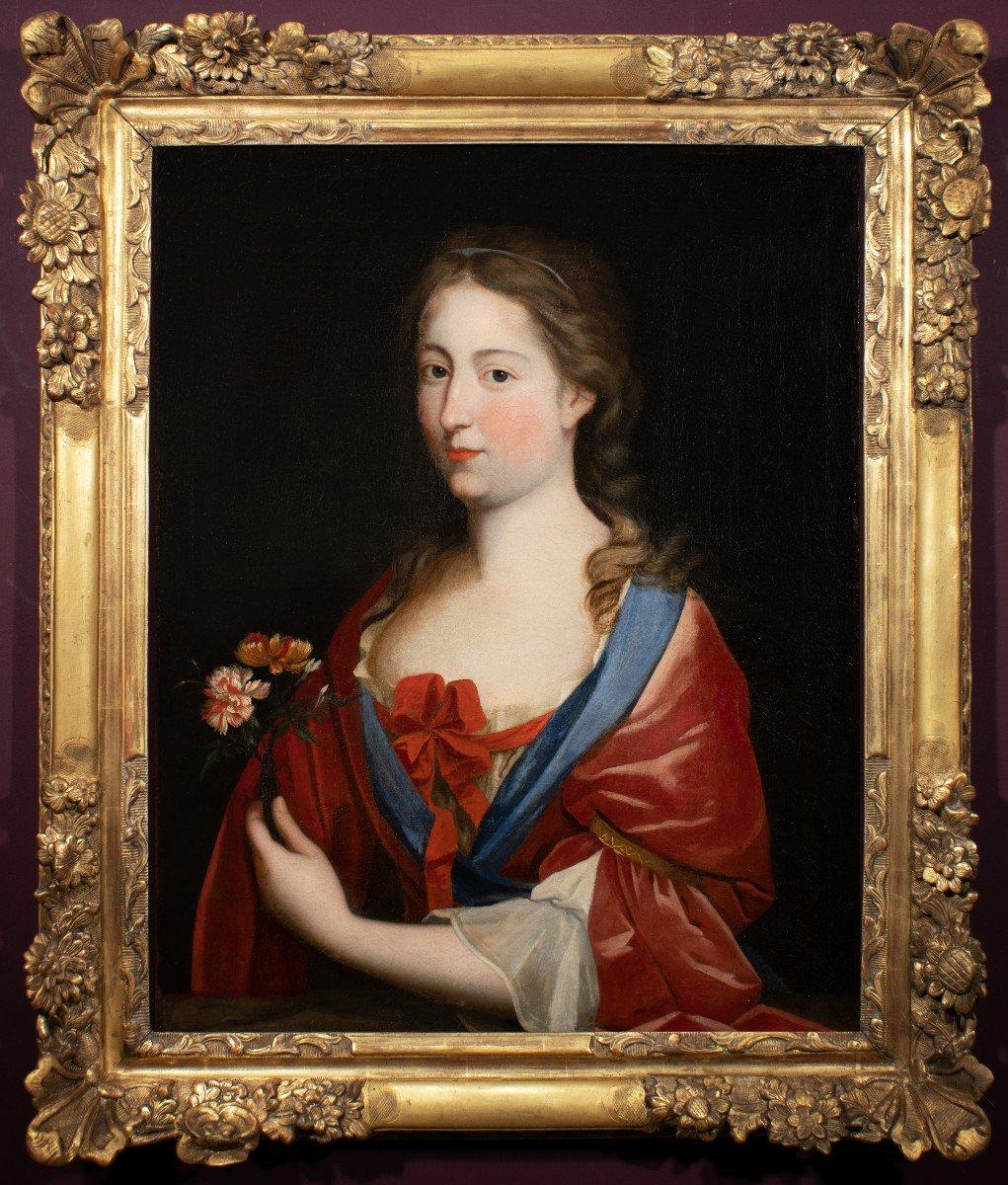 Portrait d'une Dame de qualité aux œillets, Peinture du XVIIème siècle dans son cadre d'époque.