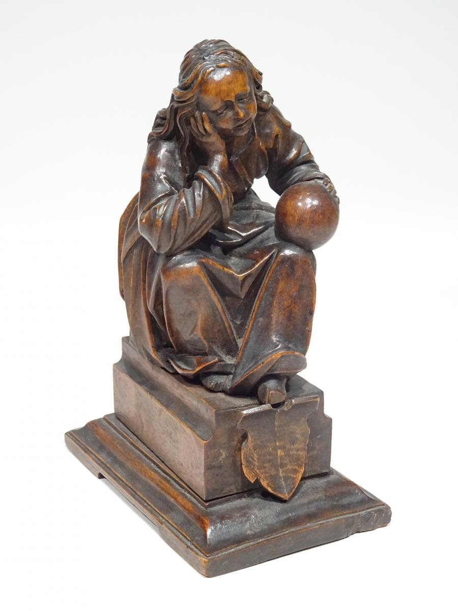 Wood Statue Representing The Geography