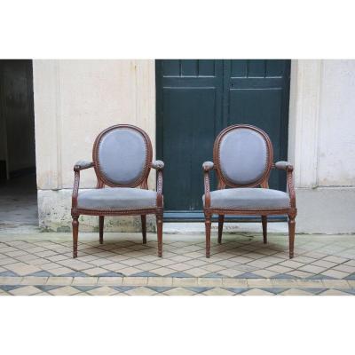Paire de fauteuil d'époque Louis XVI.