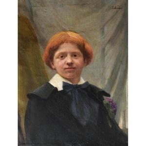 Portrait d'un jeune garçon roux.