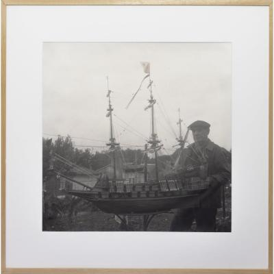 Portrait Of A Sailor With His Ship Model