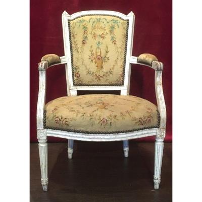 Louis XVI Cabriolet Armchair In Lacquered Beech, Au Point Tapestry. France 18th Century.