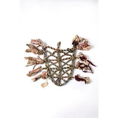 Cenderawasih bay (Geelvink Bay), Seroei, Japen Island<br /> dance ornament<br /> Label saying: Seroei (Japen Eil.) Ned. Nw Guinea<br /> Dansornament voor mannen gehangen aan een gordel.
