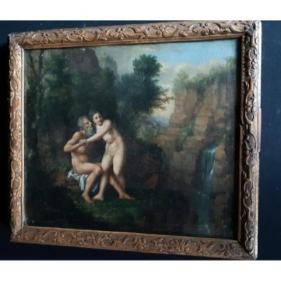 This Couple naked in a landscape is the work of the entourage of Jacques-Antoine VALLIN (1760-1831). Son of a sculptor and carver in Paris, the painter received his first training from his father. Then he returned in 1775 to the School of the Royal Academy under the protection of Dean. He participated for the 1st time in the Salon of 1791 where he exhibited regularly until 1827. Vallin, who stood out in all genres, had a marked predilection for the evocations of nymphs, bacchantes, bathers and nudes in harmonious landscapes bathed in golden light. His work is marked by the neoclassical current. He is also looking for sensitivity for pre-romantics. All these characteristics are present in this table. This naked couple, full of sensuality, stands out against a background of foliage where the atmosphere caresses the skins. The man looks lovingly at the woman, holding her by one hand, passing a leg between his, her, looking to the side. On the right, a waterfall gives clarity and freshness. This painting is on its original canvas, It has a frame with glass. Dimensions without frame: H 30 cm x W 35 cm Dimensions with frame: H 36 cm x W 41 cm<br />