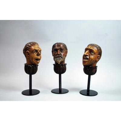 Three Grotesque Heads