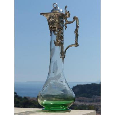 Jug from the Art Nouveau period (circa 1900) in degraded green crystal becoming white at the neck and engraved with the decoration of cherries. The floral frame is in silver metal. The crystal is perfectly clear. Jug in a perfect state.
