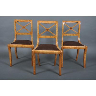 Suite de trois chaises à croisillons d'époque Charles X en frêne par J.J. WERNER.