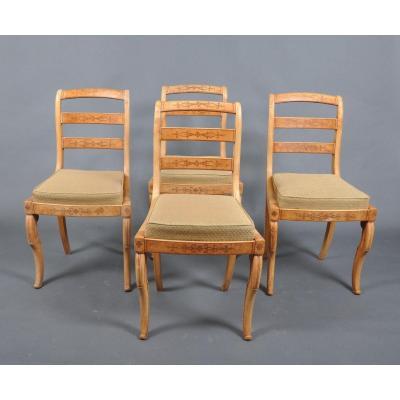 Suite de quatre chaises d'époque Charles X en frêne.