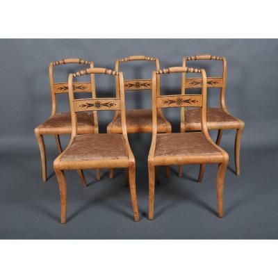 Suite de cinq chaises d'époque Charles X par J.J. WERNER en frêne.
