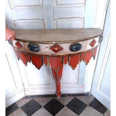 Console Italienne en bois peint à décor de lambrequins et de cabochons
