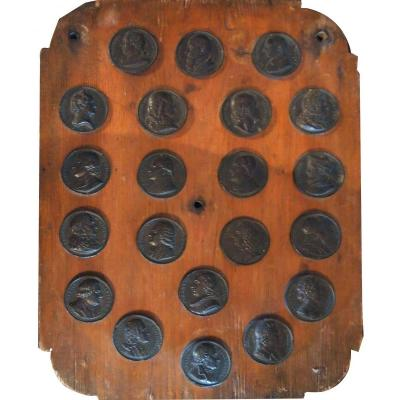 A Wooden Plate Containing Medals