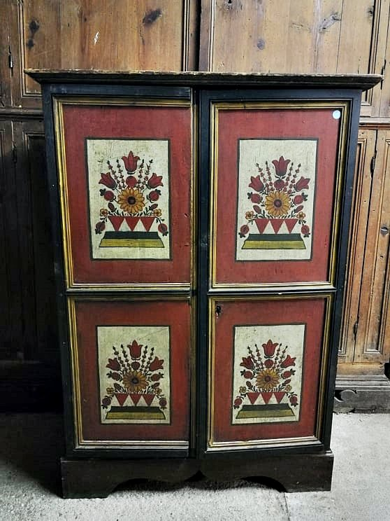 This beautiful cabinet is from the early eighteenth century and is most likely a piece of Tyrolean and Alpine culture.<br /> <br /> The mobile phone has not been restored and needs some intervention.<br /> <br /> The doors perfectly preserve their original lacquer with floral motifs divided into four quadrants.<br /> <br /> &nbsp;The measurements of the cabinet are: 132 x 95 x 50<br /> <br /> Any restoration work will be carried out before the furniture is delivered.<br /> <br /> We attach a historical certificate of authenticity to the sale.<br /> <br /> Insured and tracked shipping to be agreed with the customer.<br /> <br /> Discover our web catalog on www.antichitabompadre.com