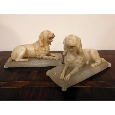 Marble puppies resting on an alabaster pillow from the early 19th century.<br />
