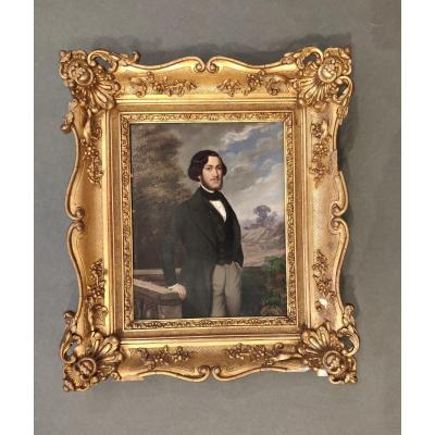 French School, Portrait of a young gentleman in a landscape, Oil on canvas in original gilt and gesso frame,  France, circa 1840's