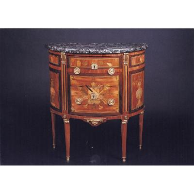 A Louis XVI Marquetery Demi-lune Commode.