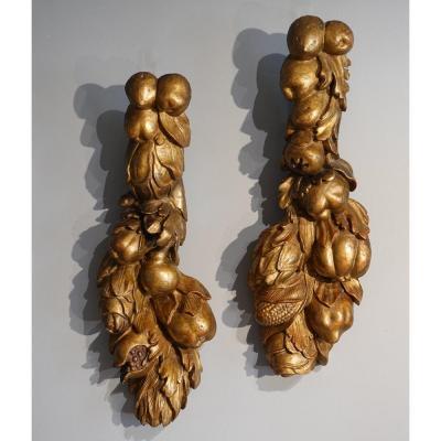 Paire de chutes en bois doré d'époque XVIII°
