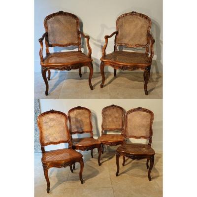 Ensemble de deux fauteuils et quatre chaises cannés Louis XV d'époque XVIII°