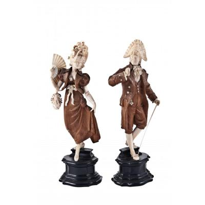 Pair Of Wood And Ivory Sculptures