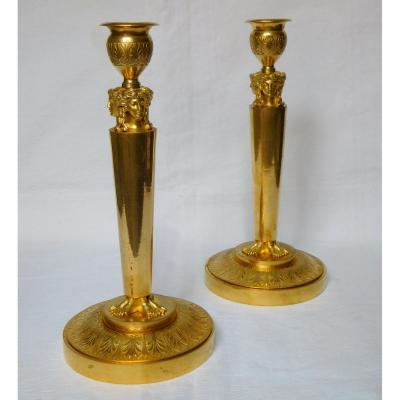 Pair of Empire ormolu candlesticks, early 19th century production.<br />
