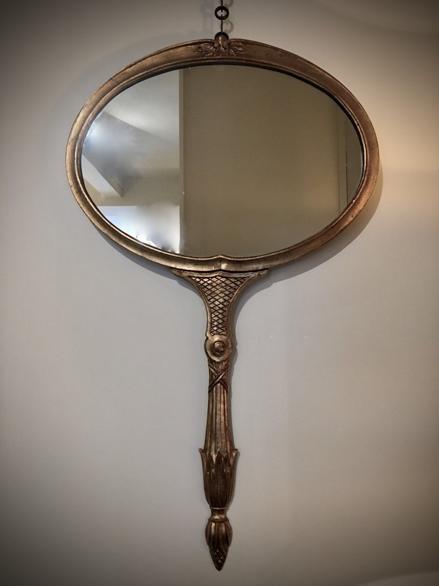 Wall Mirror In The Shape Of A Hand Mirror.