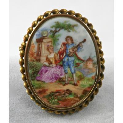 Broche début XXème en porcelaine peinte