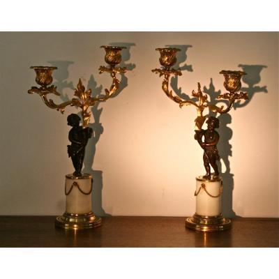 Paire De Candélabres Début XIXème Aux Putti En Bronze Doré