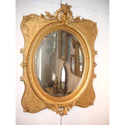 Miroir doré 19 ème / glace ovale biseautée