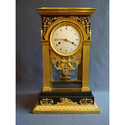 Empire Period Porcelain Clock In Gilded Bronze
