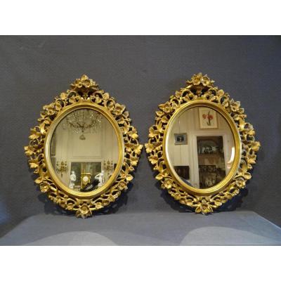 Paire de miroirs en bois doré XIX eme
