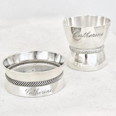 Cute set of egg cup and napkin ring in solid silver engraved with CATHERINE's name, dating from the mid-twentieth century, H&C goldsmith's mark and Minervas' head. Total weight: 55 grams. Egg cup: Height: 4cm / Napkin ring: diameter: 5 cm