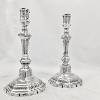 Somptuous pair of candlesticks in sterling silver , city hallmark of Nantes for the period 1750-1756. Silversmith&#39;s mark of Gabriel Graves who later moved &nbsp;to Bordeaux. They are beautifully engraved which is quite rare.<br /> Weight 1100 grams.