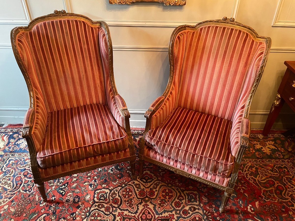 Pair Of Bergères With Ears Of Louis XVI Style, In Golden Wood.