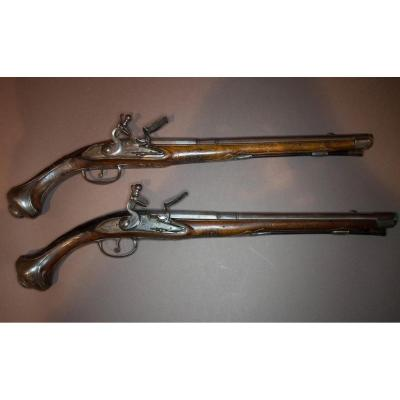 Long Pair Of Flintlock Pistols. Round Cannons With Thunders Engraved From Feuillag