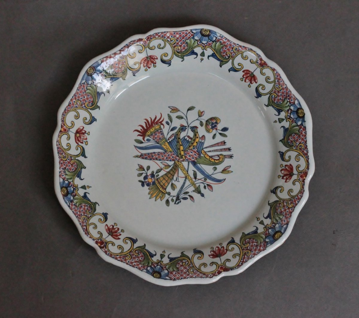Rouen Earthenware Plate With Quiver Decor, Eighteenth Century.