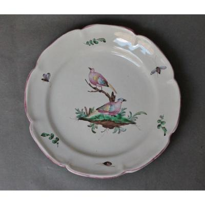 Aprey Earthenware Plate With Bird Decor. Eighteenth Century.