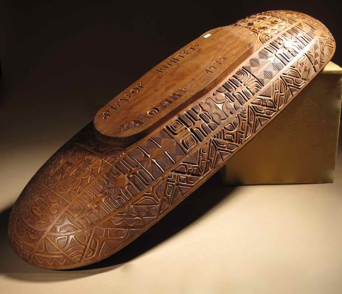 A Very Large Magnificent Important And Beautifully Carved Long Wooden Bowl,