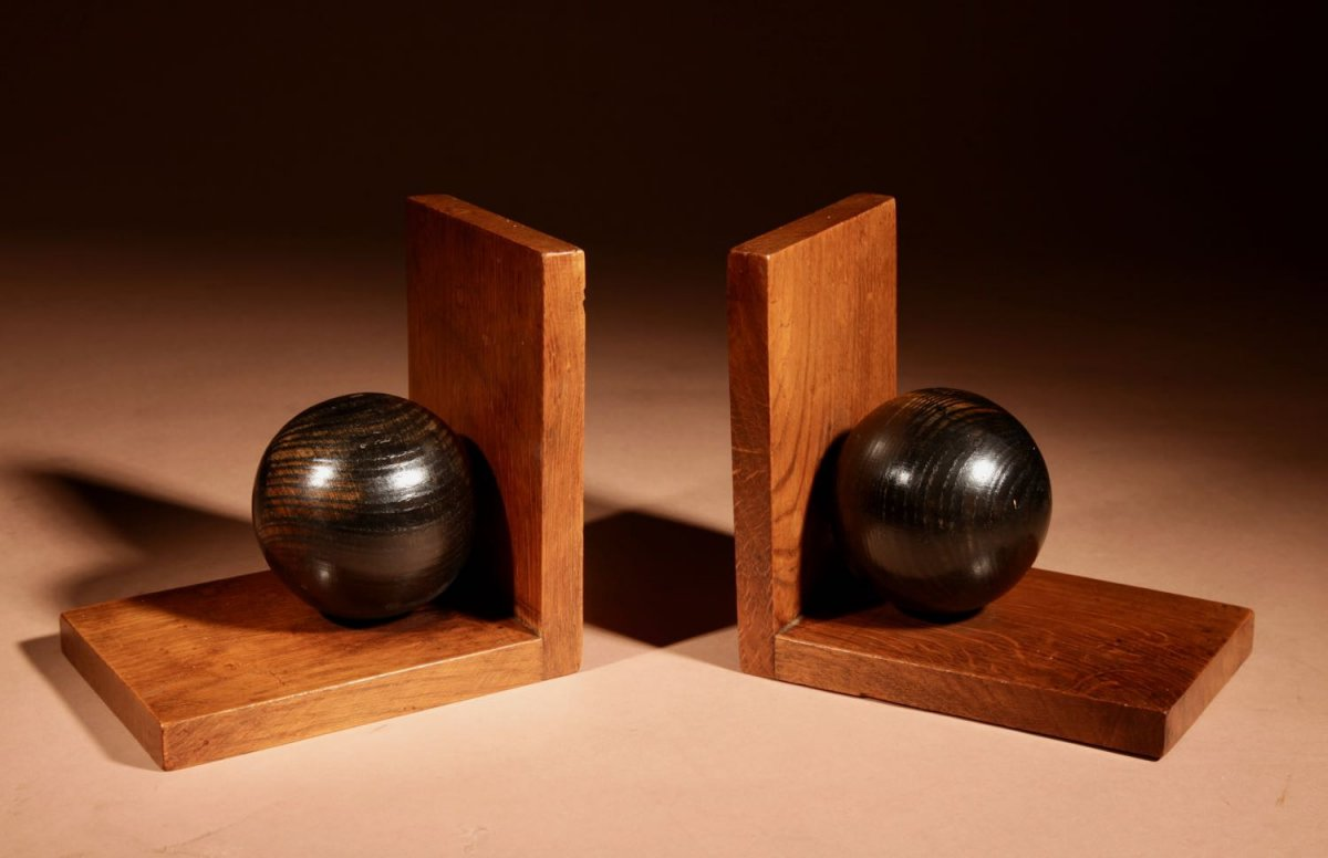 A Pair Of Decorative Oak And Ebonised Amsterdam School Bookends.