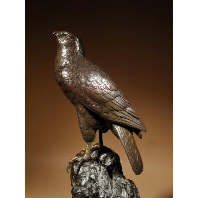 A Very Decorative Bronze Model Of A Hawk Sitting On A Craggy Rock.