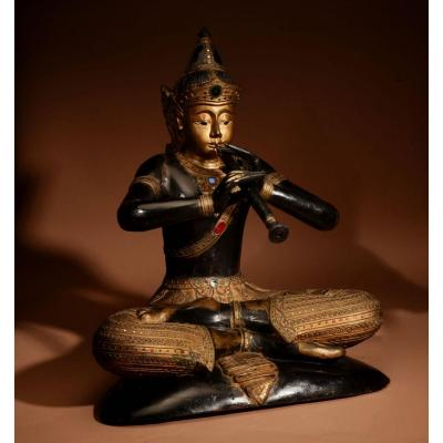 A Large Wooden Sculpture Of The Famous Prince Phra Aphai Mani Playing His Magic Flute, Thailand