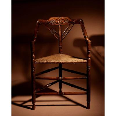 A Very Decorative Elmwood Triangle Armchair Circa 1900.