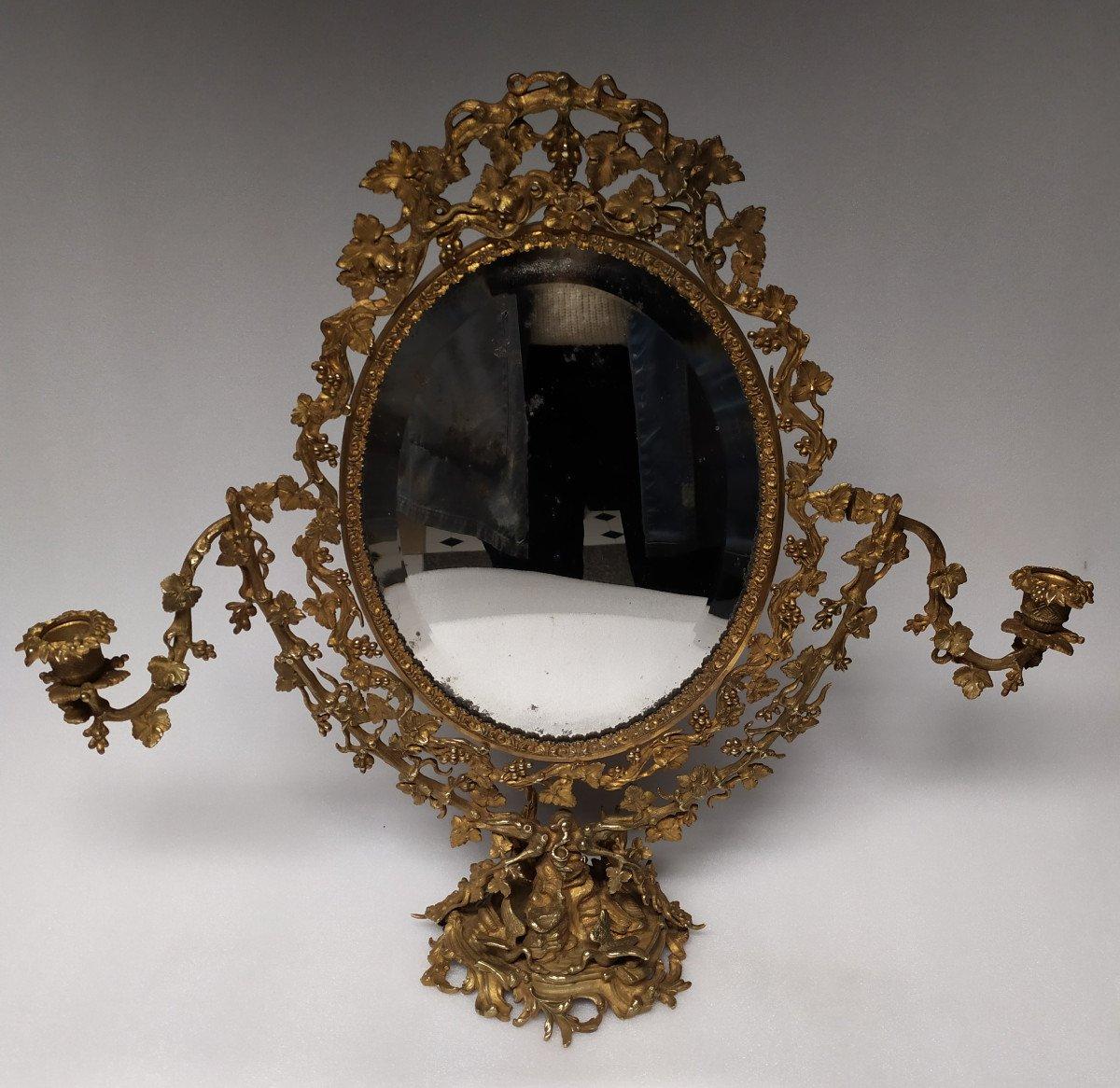 Miroir Psyché de toilette en bronze doré– XIXème Siècle.