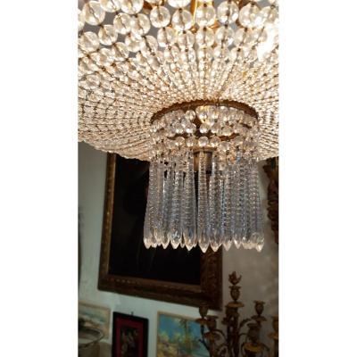 """Lustre réalisé par la Maison BACCARAT dit """"Lustre à couronne"""". Cristal & bronze doré. Nap III."""