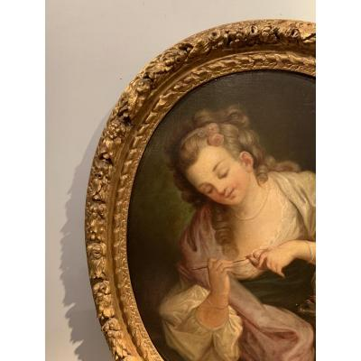 Oil on canvas depicting a young woman feeding nestlings in their nest. Very beautiful frame in gilded wood and carved with a garland of flowers and fruits, Regency Period. Re-linings and old restorations. French school of the end of the 18th century to be compared to works by JB Greuze (1725-1805)