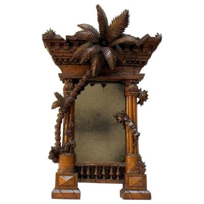 A French 19th Century Orientalist Carved Walnut Frame Modelled As A Classical Ruin