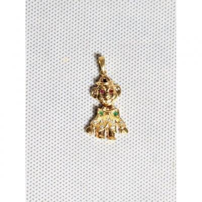 18k gold pendant set with precious stones (diamonds, rubies, emerald ...) representing a clown with an articulated head. Gross weight 3.41 gr and 3.5 cm long. Period XXth.