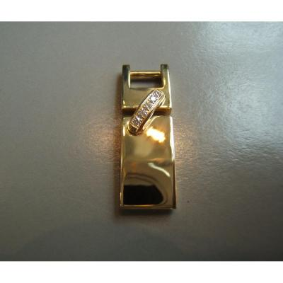 """""""CHAUMET"""" Links pendant in yellow gold and diamonds. It is signed and numbered and in mint condition It is supported by an original black cord on each end with a gold cap. Weight: 5.52grs. Box and protective box."""